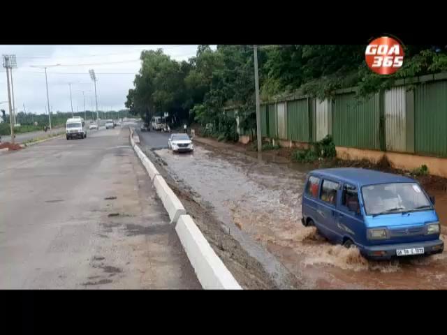 The road oppsite GMC floods as gutters choke