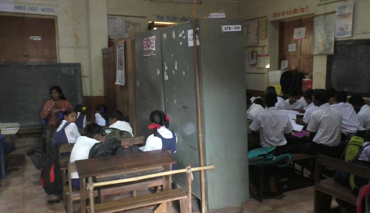 Divided with cupboards, they study in one hall in Mulgao school