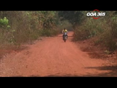 The mud road of a State Highway in a thick forest of Sanguem…